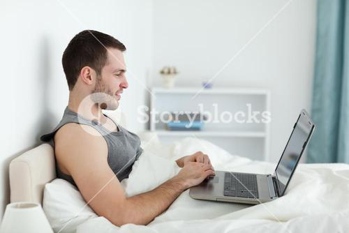 Quiet man using a laptop
