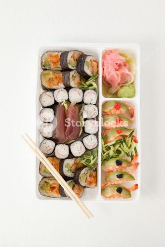 Assorted sushi set served with chopsticks in white box