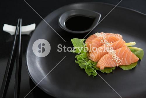 Sashimi served on plate with soy sauce