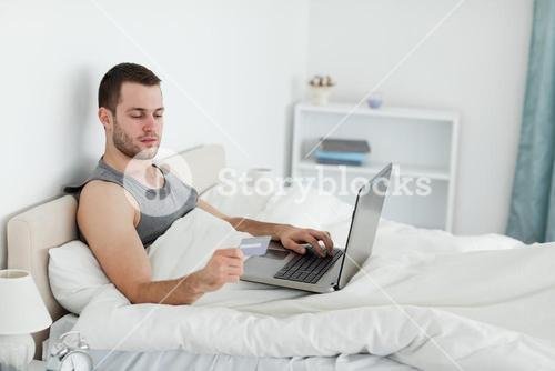 Young man purchasing online