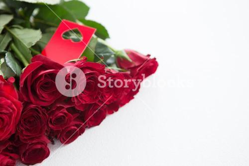Bunch of red roses with tag