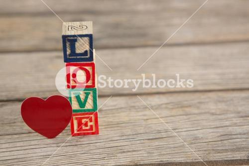Blocks displaying love message and Red heart shape