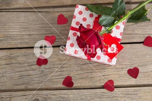 Gift box surrounded with rose