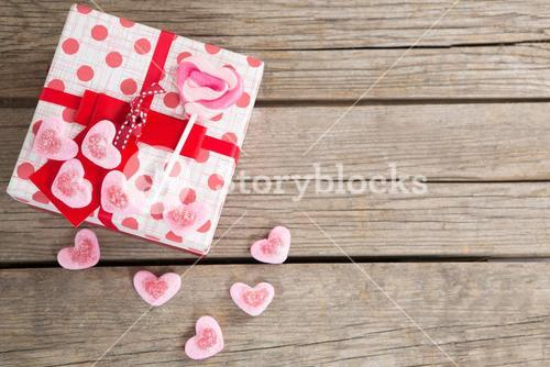 Gift box surrounded with confectionery