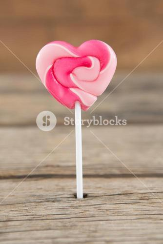 Close-up of pink heart shaped lollipop