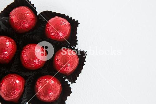 Chocolates wrapped on red paper