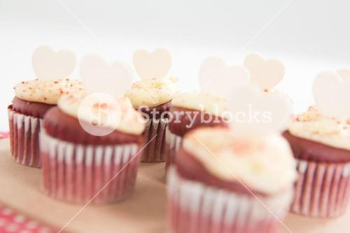 Cup cakes on heart shape paper