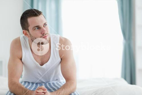 Quiet man sitting on his bed