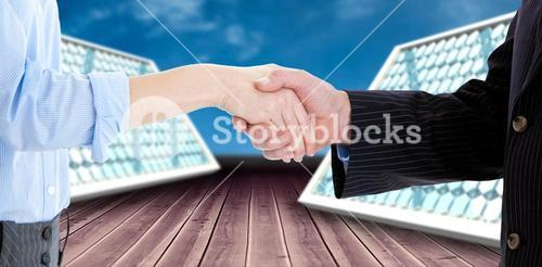 Composite image of close up of a business people closing a deal 3d
