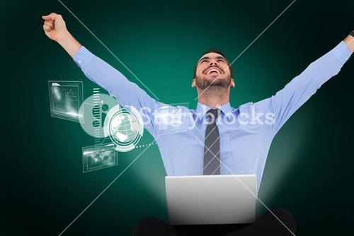 Composite image of businessman sitting on the floor cheering