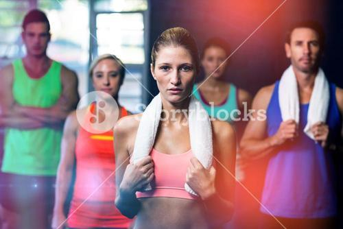 Portrait of serious young friends in gym