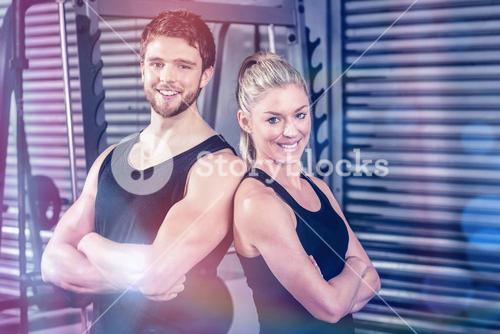 Fit couple with arm crossed