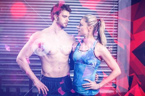 Athletic couple staring into each other in eyes