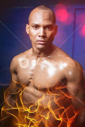Portrait of male athlete against wall