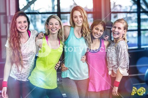 Fit group posing and smiling