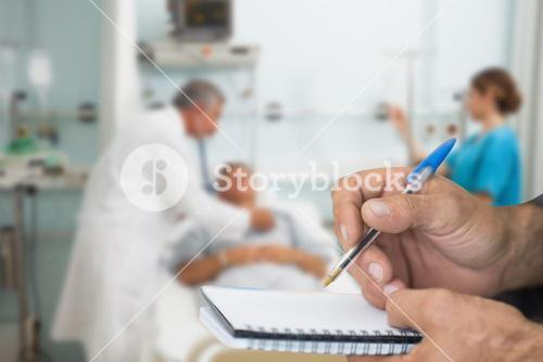 Composite image of doctor checking patient with stethoscope