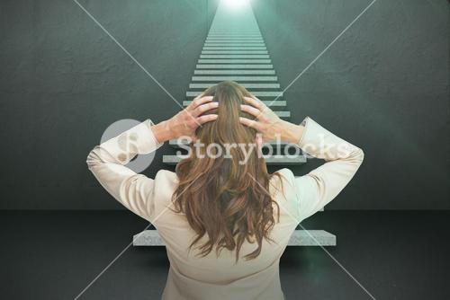 Composite image of young classy businesswoman with hands on head standing back to camera 3d