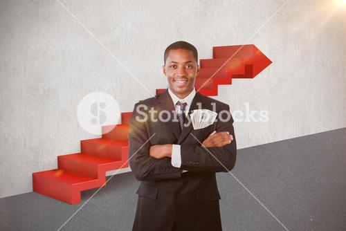 Composite image of handsome businessman with dollars in a pocket 3d