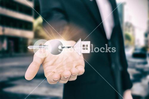 Composite image of high angle view of home keychain with silver key