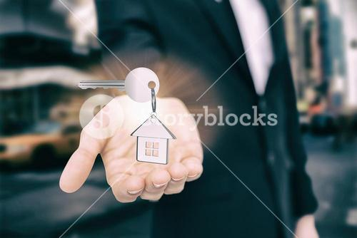 Composite image of silver key with ring