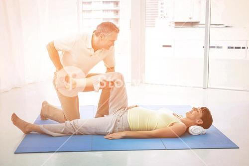 Physiotherapist giving physiotherapy to pregnant woman