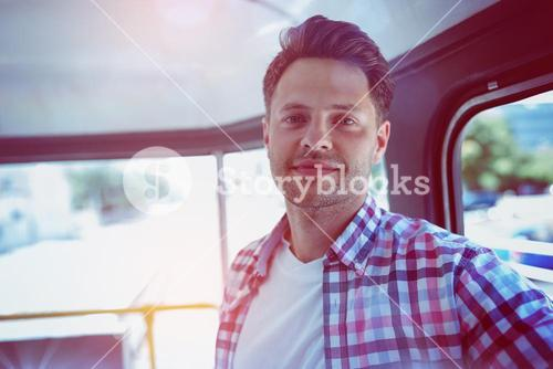 Portrait of man traveling in bus