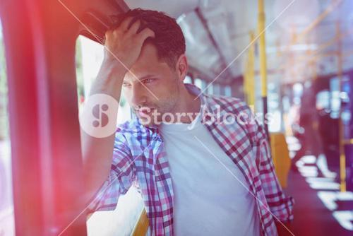 Handsome man travelling in bus