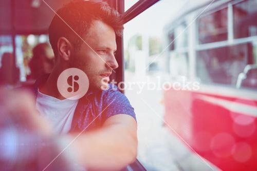 Close up of man traveling in bus