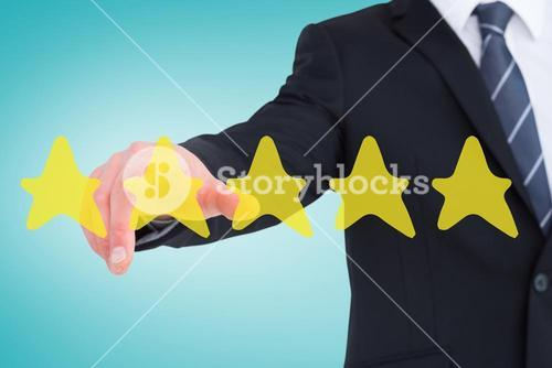 Composite image of businessman in suit pointing his finger
