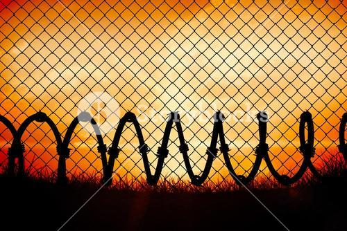 Composite image of chainlink fence against  white background