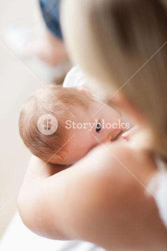 Above view of baby getting breastfed