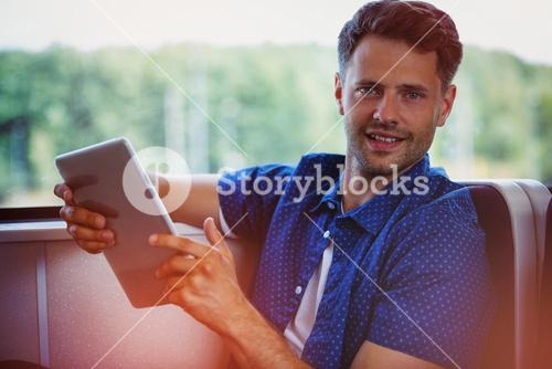 Portrait of young man using digital tablet