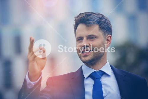 Close up of cheerful businessman gesturing