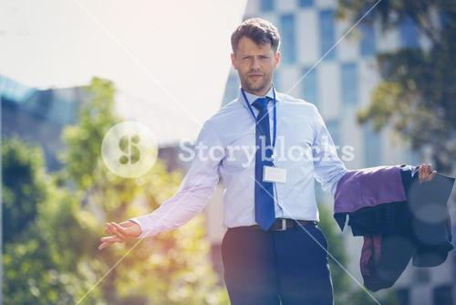 Portrait of confused businessman standing with blazer