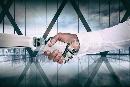 Composite image of computer graphic image of businessman and robot shaking hands