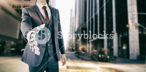 Composite image of businessman with robotic hand approaching for handshake