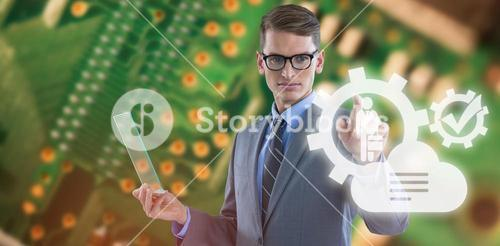 Composite image of businessman holding glass sheet and touching invisible screen
