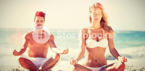 Happy couple doing yoga