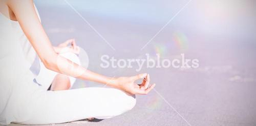 Midsection of woman performing yoga