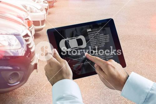 Composite image of businessman using digital tablet next to smartphone