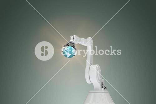 Composite image of vector image of robotic arm holding globe 3d