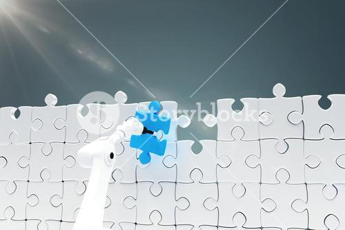 Composite image of robotic arm holding blue jigsaw piece by puzzle 3d