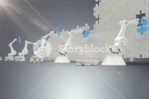 Composite image of robotic arms arranging blue jigsaw piece on puzzle 3d