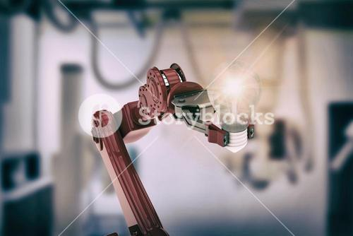 Composite image of illustrative image of robotic hand holding light bulb 3d