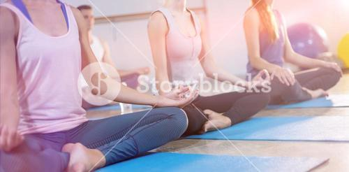 Group of women performing yoga