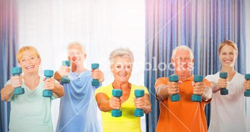 Portrait of seniors exercising with weights