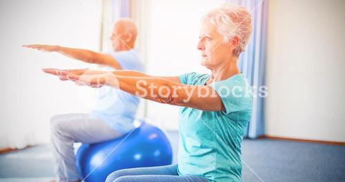 Seniors using exercise ball