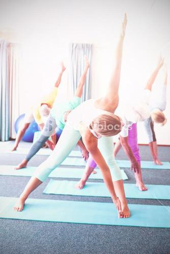 Instructor performing yoga with seniors