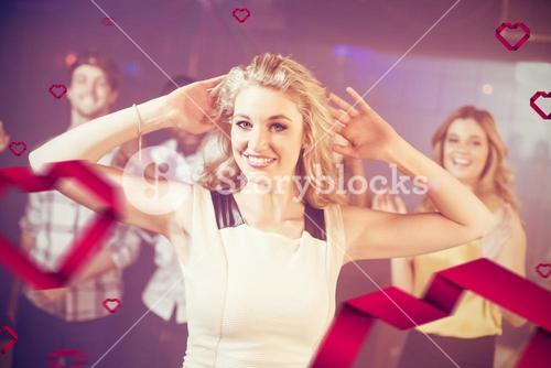 Composite image of portrait of cheerful woman dancing cheerfully