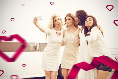 Composite image of well dressed women taking selfie